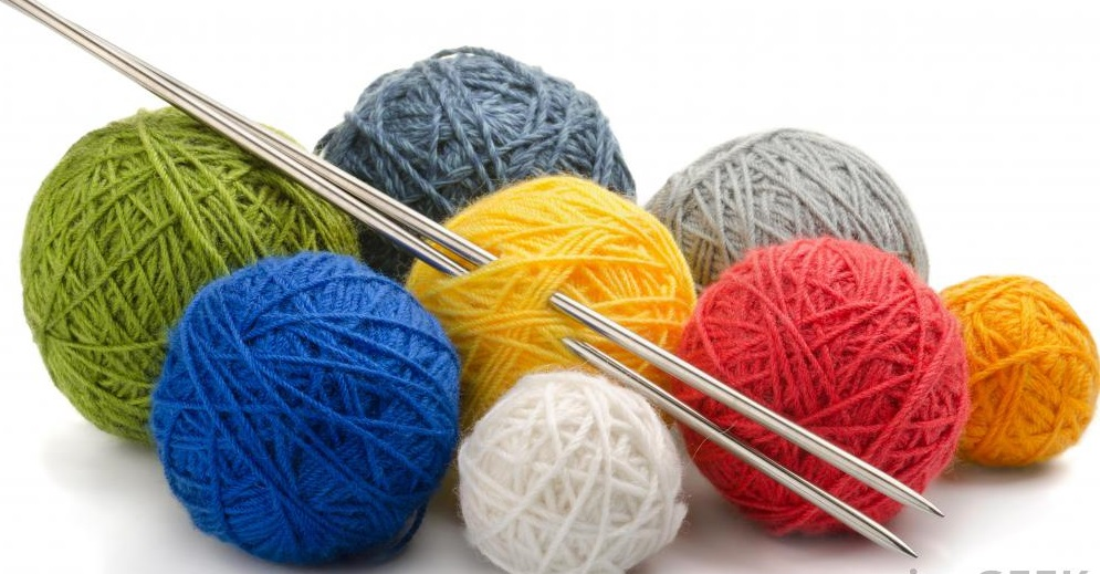 knitting-thread-and-needles-against-white-background